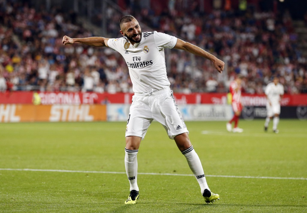 Real Madrid's French forward Karim Benzema celebrates his second goal during the Spanish league football match between Girona FC and Real Madrid CF at the Montilivi stadium in Girona on August 26, 2018. (Photo by Pau BARRENA CAPILLA / AFP) (Photo credit should read PAU BARRENA CAPILLA/AFP/Getty Images)