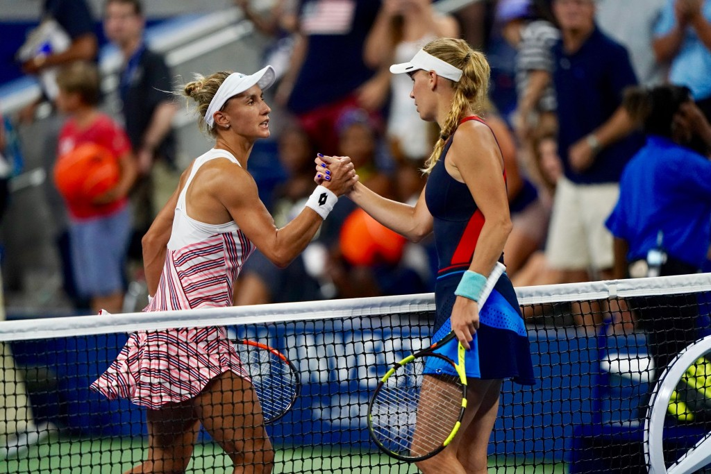 Lesia Tsurenko of Ukraine (L) shakes hands with Caroline Wozniacki of Denmark (R) after defeating her during their 2018 US Open Women's Singles match at the USTA Billie Jean King National Tennis Center in New York on August 30, 2018. (Photo by EDUARDO MUNOZ ALVAREZ / AFP) (Photo credit should read EDUARDO MUNOZ ALVAREZ/AFP/Getty Images)