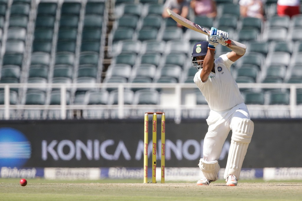 Indian batsman Cheteshwar Pujara plays a shot during the first day of the third test match between South Africa and India at Wanderers cricket ground on January 24, 2018 in Johannesburg. / AFP PHOTO / GIANLUIGI GUERCIA (Photo credit should read GIANLUIGI GUERCIA/AFP/Getty Images)