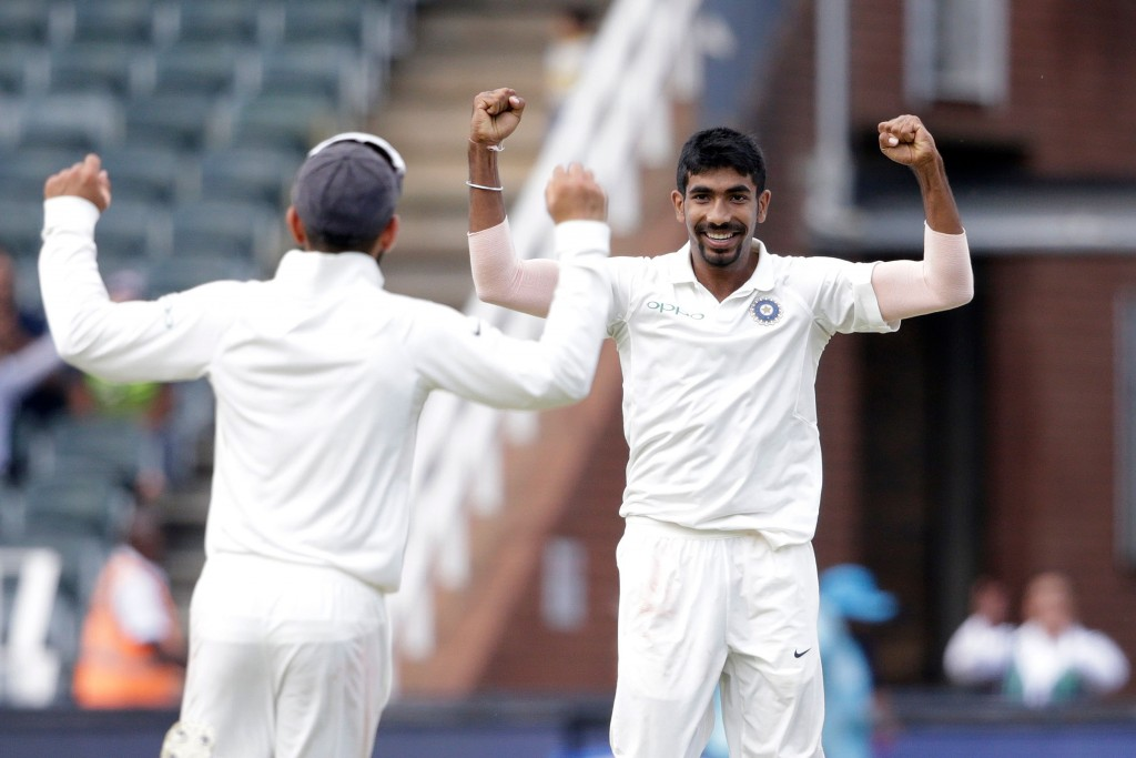Indian bowler Jasprit Bumrah (R) celebrates the dismissal of South African batsman Lungi Ngidi during the second day of the third test match between South Africa and India at Wanderers cricket ground on January 25, 2018 in Johannesburg. / AFP PHOTO / GIANLUIGI GUERCIA (Photo credit should read GIANLUIGI GUERCIA/AFP/Getty Images)