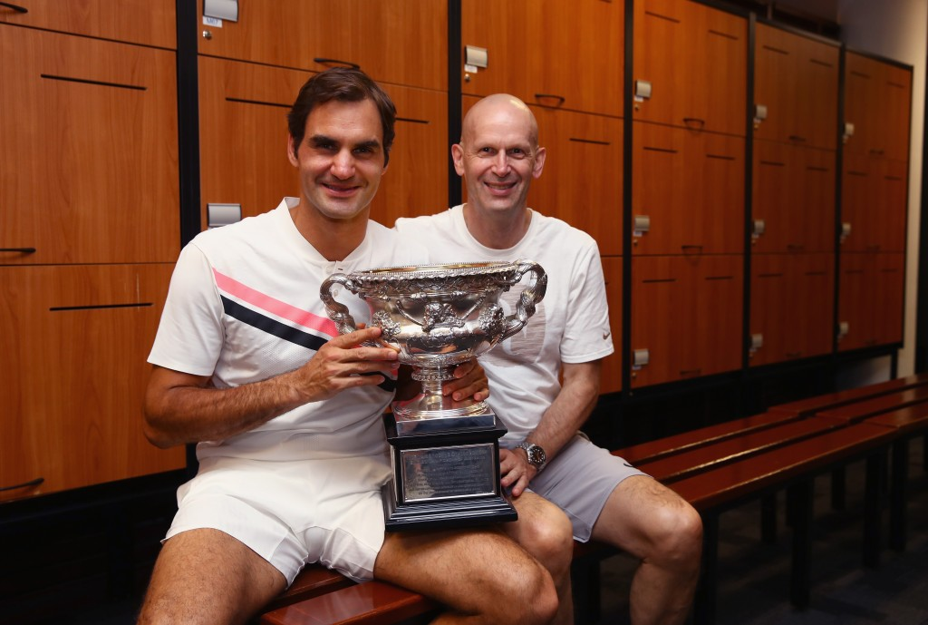 MELBOURNE, AUSTRALIA - JANUARY 28: Roger Federer of Switzerland and physio Daniel Troxler pose with the Norman Brookes Challenge Cup in the players locker room after winning the Men's Singles Final against Marin Cilic of Croatia on day 14 of the 2018 Australian Open at Melbourne Park on January 28, 2018 in Melbourne, Australia. (Photo by Clive Brunskill/Getty Images)