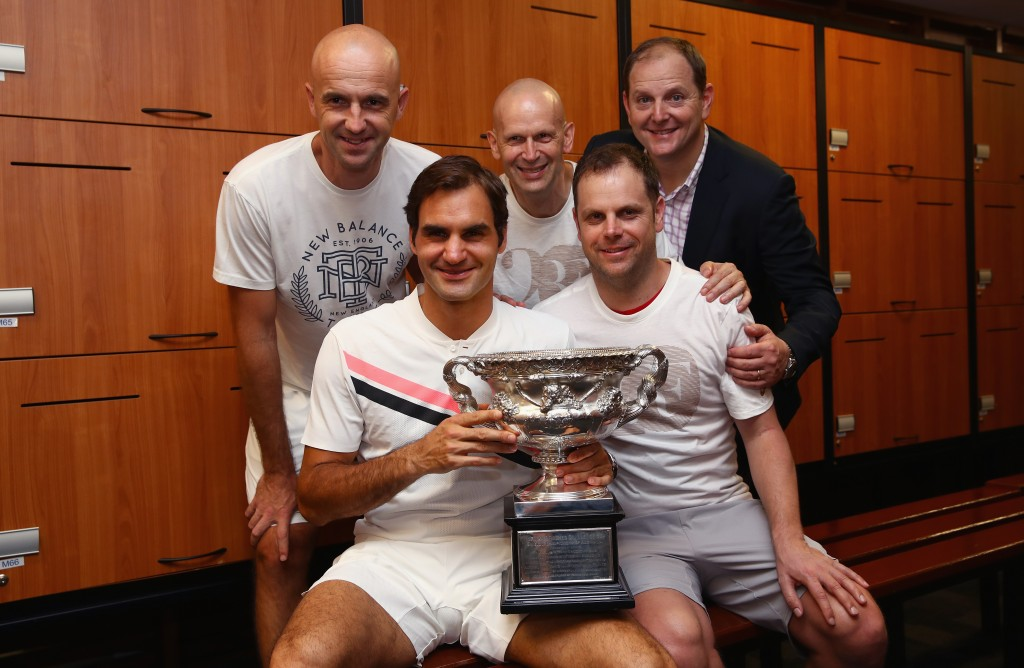 MELBOURNE, AUSTRALIA - JANUARY 28: L-R Front Row Roger Federer of Switzerland, Severin Luthi,coach Back Row L-R Ivan Ljubicic, coach,Daniel Troxler, physio and Tony Godsick,agent pose with the Norman Brookes Challenge Cup in the players locker room after winning the Men's Singles Final against Marin Cilic of Croatia on day 14 of the 2018 Australian Open at Melbourne Park on January 28, 2018 in Melbourne, Australia. (Photo by Clive Brunskill/Getty Images)