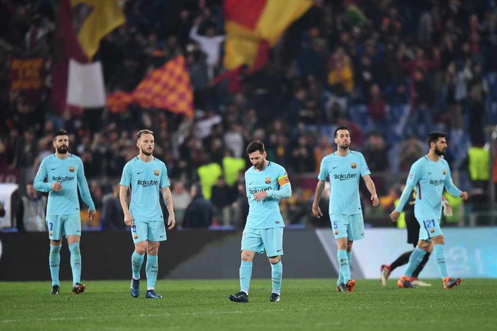 ROME, ITALY - APRIL 10: Lionel Messi and team mates look dejected after Roma's third goal the UEFA Champions League Quarter Final Second Leg match between AS Roma and FC Barcelona at Stadio Olimpico on April 10, 2018 in Rome, Italy. (Photo by Michael Regan/Getty Images)