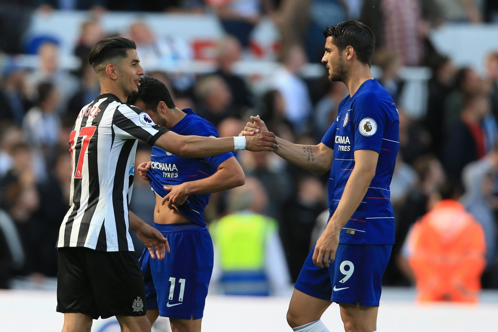 Arsenal's Spanish striker Lucas Perez (L) greets Chelsea's Spanish striker Alvaro Morata after winning the English Premier League football match between Newcastle United and Chelsea at St James' Park in Newcastle-upon-Tyne, north east England on May 13, 2018. (Photo by Lindsey PARNABY / AFP) / RESTRICTED TO EDITORIAL USE. No use with unauthorized audio, video, data, fixture lists, club/league logos or 'live' services. Online in-match use limited to 75 images, no video emulation. No use in betting, games or single club/league/player publications. / (Photo credit should read LINDSEY PARNABY/AFP/Getty Images)