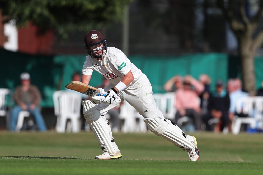 GUILDFORD, ENGLAND - JUNE 20: Ollie Pope of Surrey hits out during day 1 of the Specsavers County Championship Division One match between Surrey and Somerset on June 20, 2018 in Guildford, England. (Photo by Sarah Ansell/Getty Images).