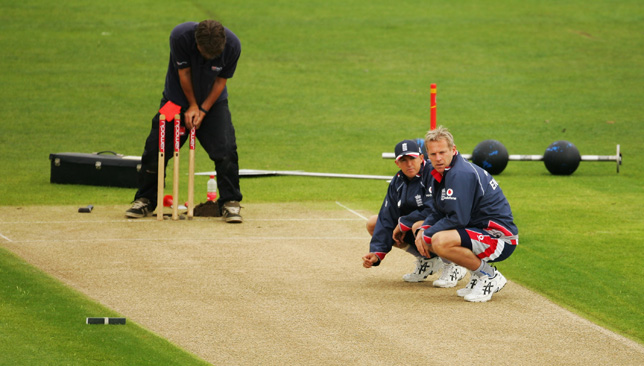 England coach Peter Moores (right) and assistant coach Andy Flower inspect the pitch