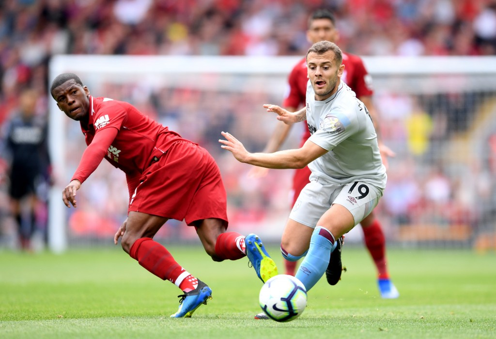 LIVERPOOL, ENGLAND - AUGUST 12: Jack Wilshere of West Ham United battles for possession with Georginio Wijnaldum of Liverpool during the Premier League match between Liverpool FC and West Ham United at Anfield on August 12, 2018 in Liverpool, United Kingdom. (Photo by Laurence Griffiths/Getty Images)