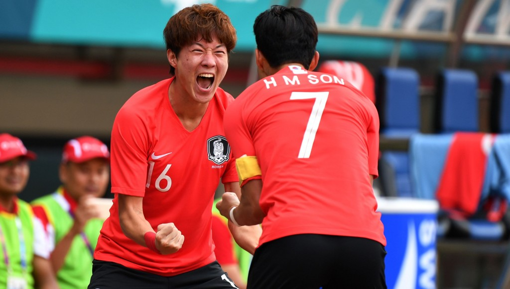 South Korea's hat-trick hero Hwang Ui-jo celebrates a goal with captain Son Heung-min.