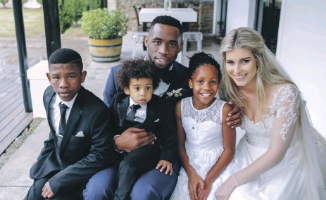 Kolisi with his wife Rachel, son Nicholas (on his lap) and half siblings, Liyema (l) and Liphelo.