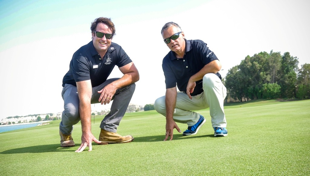 Alex McDowell (l) and Graeme MacNiven inspect the course.