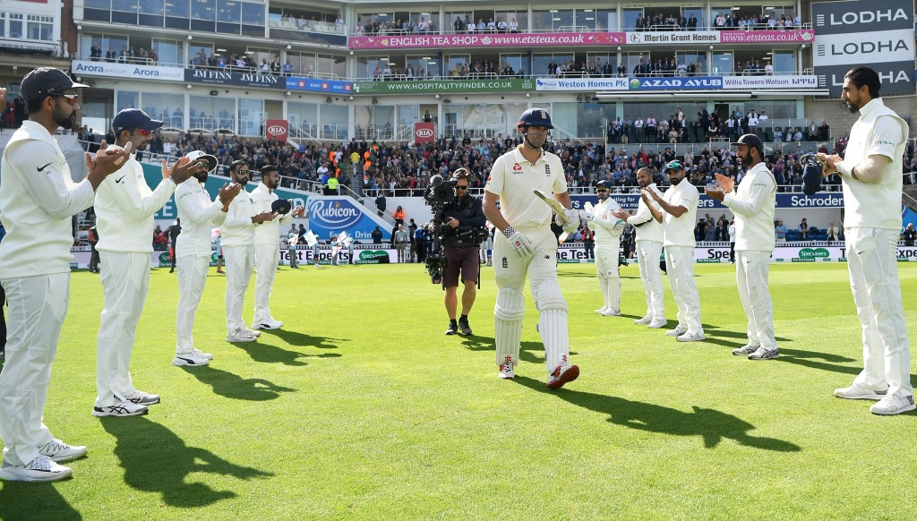 Alastair Cook is given a guard of honour as he walks out to bat in the Fifth Test