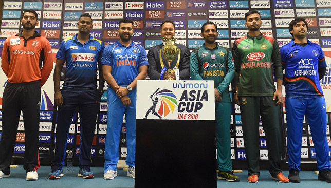 Six captains with the Asia Cup trophy in Dubai.