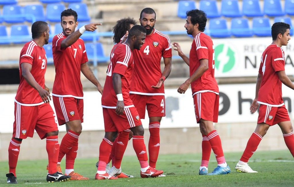 The UAE players celebrate against Laos.