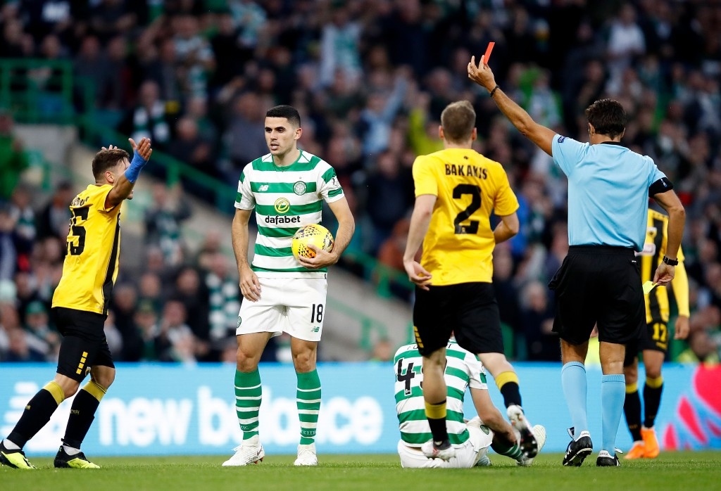 Kostas Galanopoulas of AEK Athens receives a red card at Celtic in this season's qualifiers.