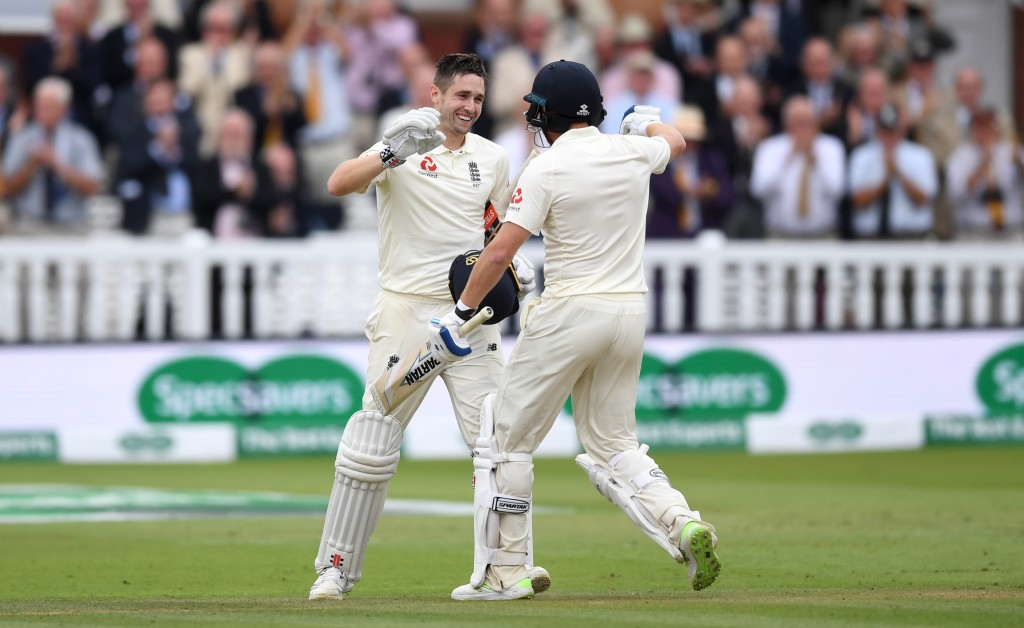 LONDON, ENGLAND - AUGUST 11: Chris Woakes of England celebrates reaching his century with teammate Jonathan Bairstow during day three of the 2nd Specsavers Test between England and India at Lord's Cricket Ground on August 11, 2018 in London, England. (Photo by Gareth Copley/Getty Images)