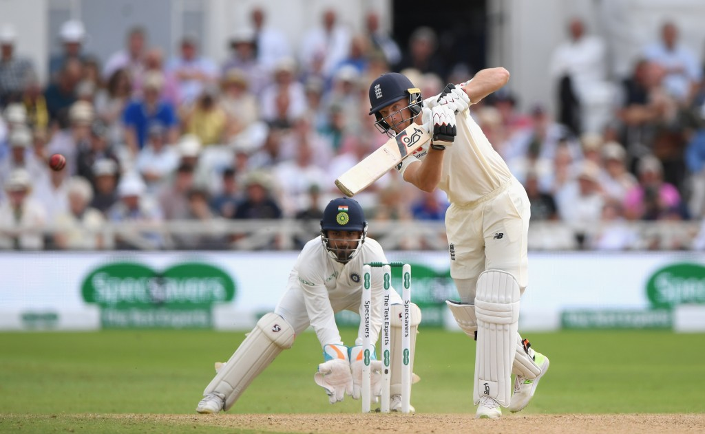 NOTTINGHAM, ENGLAND - AUGUST 21: England batsman Jos Buttler drives a ball to the boundary watched by wicketkeeper Pant during day four of the 3rd Specsavers Test Match between England and India at Trent Bridge on August 21, 2018 in Nottingham, England. (Photo by Stu Forster/Getty Images)