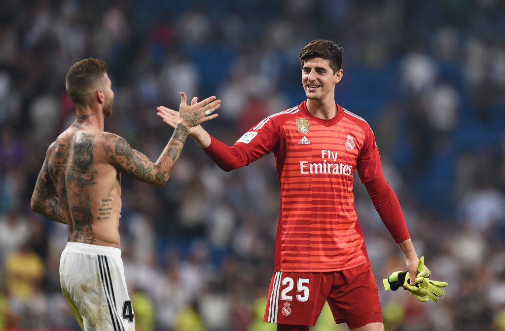 MADRID, SPAIN - SEPTEMBER 01: Thibaut Courtois of Real Madrid is congratulated by teammate Sergio Ramos after playing his first La Liga match during the La Liga match between Real Madrid CF and CD Leganes at Estadio Santiago Bernabeu on September 1, 2018 in Madrid, Spain. (Photo by Denis Doyle/Getty Images)
