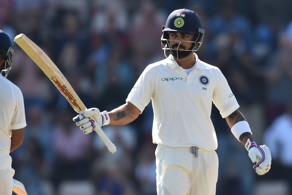 India's captain Virat Kohli celebrates reaching his fifty during play on the fourth day of the fourth Test cricket match between England and India at the Ageas Bowl in Southampton, southwest England on September 2, 2018. (Photo by Glyn KIRK / AFP) / RESTRICTED TO EDITORIAL USE. NO ASSOCIATION WITH DIRECT COMPETITOR OF SPONSOR, PARTNER, OR SUPPLIER OF THE ECB (Photo credit should read GLYN KIRK/AFP/Getty Images)