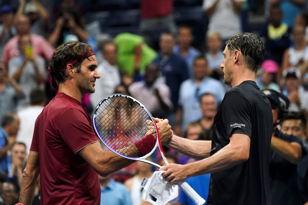 Australia's John Millman (R) shakes hands with Switzerland's Roger Federer after defeating him during their 2018 US Open Men's Singles tennis match at the USTA Billie Jean King National Tennis Center in New York on September 3, 2018. - Five-time champion Roger Federer crashed out of the US Open fourth round, beaten in four sets by 55th-ranked Australian John Millman. (Photo by EDUARDO MUNOZ ALVAREZ / AFP) (Photo credit should read EDUARDO MUNOZ ALVAREZ/AFP/Getty Images)