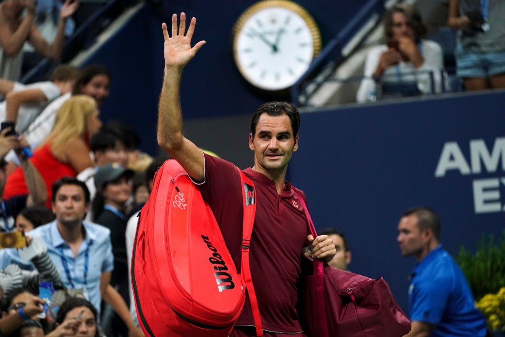 Switzerland's Roger Federer waves as he walks off court after losing his 2018 US Open Men's Singles tennis match against Australia's John Millman at the USTA Billie Jean King National Tennis Center in New York on September 3, 2018. - Five-time champion Roger Federer crashed out of the US Open fourth round, beaten in four sets by 55th-ranked Australian John Millman. (Photo by EDUARDO MUNOZ ALVAREZ / AFP) (Photo credit should read EDUARDO MUNOZ ALVAREZ/AFP/Getty Images)