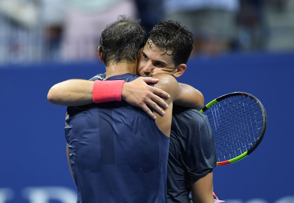 Rafael Nadal embraces Dominic Thiem.