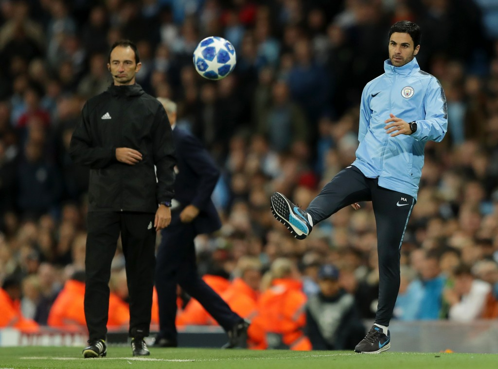 Mikel Arteta, Manchester City coach kicks the ball during this Group F-match.