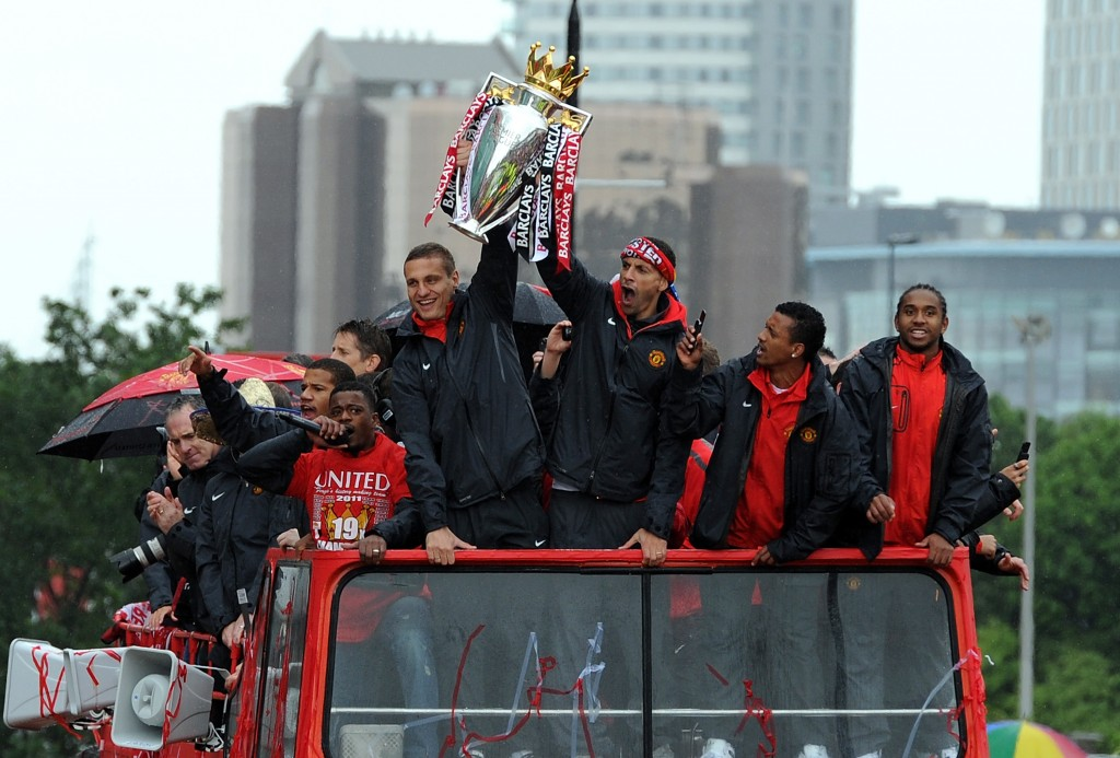MANCHESTER, ENGLAND - MAY 30: Rio Ferdinand (R) and Nemanja Vidic of Manchester United lift the trophy during the Manchester United Premier League Winners Parade at Old Trafford on May 30, 2011 in Manchester, United Kingdom. (Photo by Chris Brunskill/Getty Images)