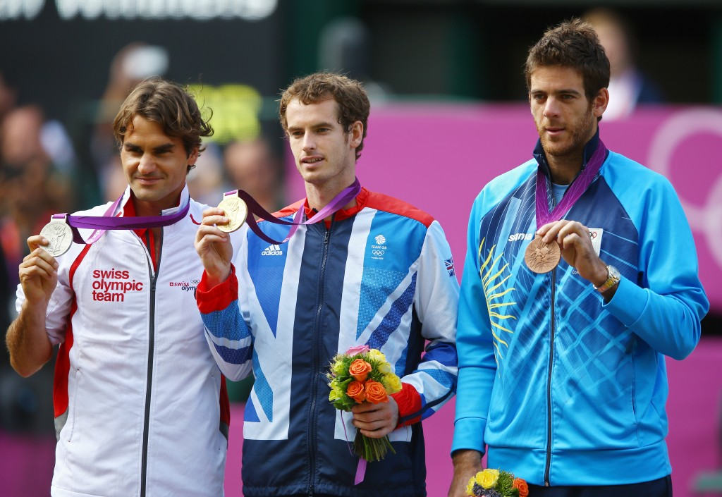 LONDON, ENGLAND - AUGUST 05: Silver medalist Roger Federer (L) of Switzerland, gold medalist Andy Murray (C) of Great Britain and bronze medalist Juan Martin Del Potro of Argentina pose during the medal ceremony for the Men's Singles Tennis match on Day 9 of the London 2012 Olympic Games at the All England Lawn Tennis and Croquet Club on August 5, 2012 in London, England. Murray defeated Federer in the gold medal match in straight sets 2-6, 1-6, 4-6. (Photo by Paul Gilham/Getty Images)