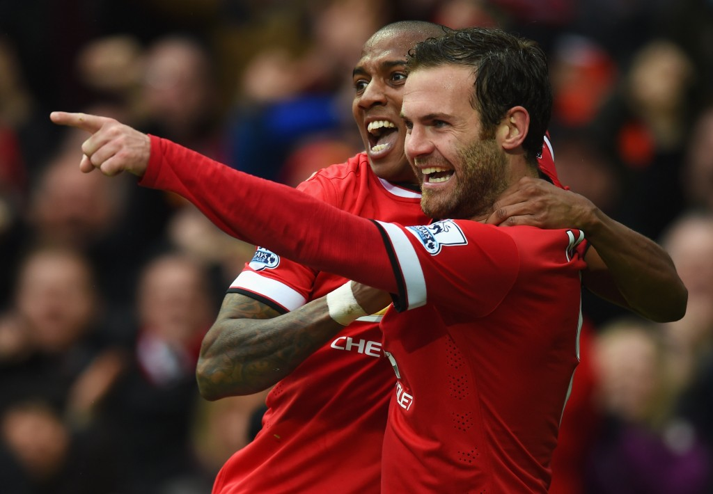 MANCHESTER, ENGLAND - APRIL 12: Juan Mata of Manchester United celebrates with Ashley Young as scores their third goal during the Barclays Premier League match between Manchester United and Manchester City at Old Trafford on April 12, 2015 in Manchester, England. (Photo by Michael Regan/Getty Images)