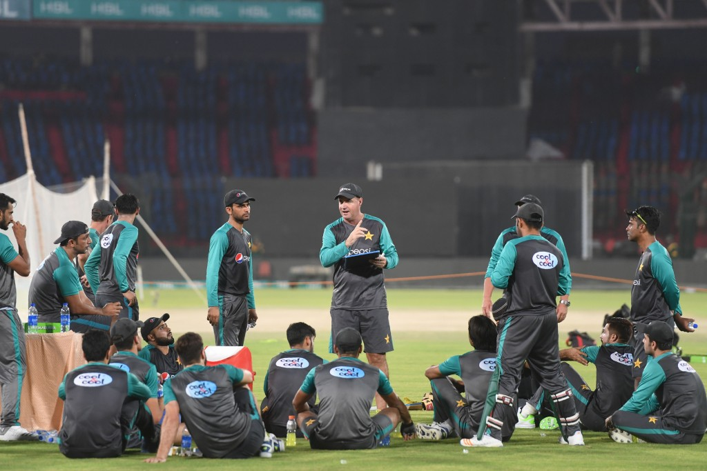 All ears as the coach speaks: Pakistan cricket team.