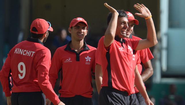 Hong Kong bowler Ehsan Khan (r).