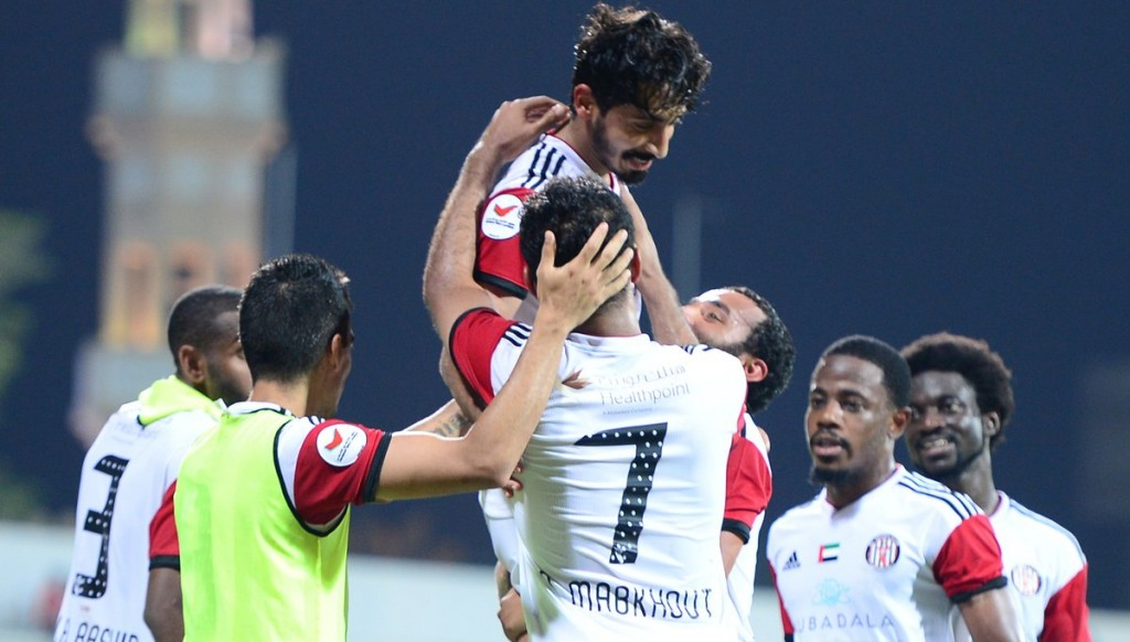 Khalfan Mubarak is hoisted high by his Jazira teammates.