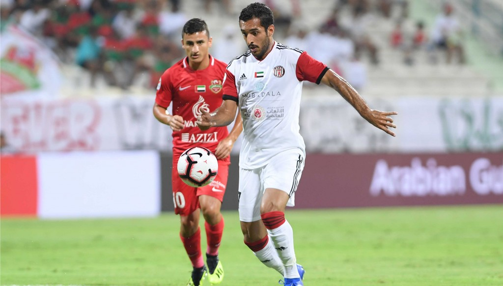 Ali Mabkhout scored a hat-trick as Al Jazira won a manic game 5-4 against Shabab Al Ahli.