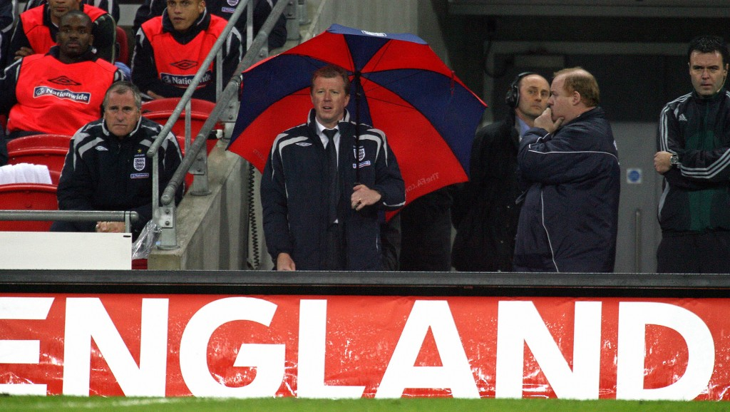 Steve McLaren under an umbrella would become an infamous picture.