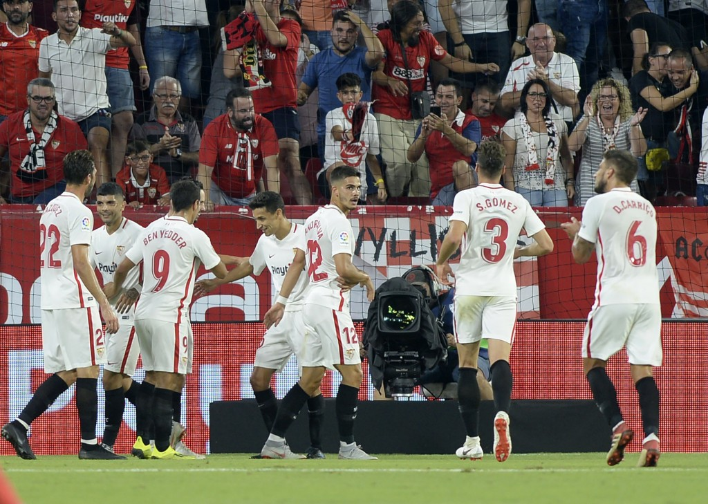 Sevilla's Portuguese forward Andre Silva (C) celebrates after scoring a goal during the Spanish league football match Sevilla FC against Real Madrid CF at the Ramon Sanchez Pizjuan stadium in Seville on September 26, 2018. (Photo by CRISTINA QUICLER / AFP) (Photo credit should read CRISTINA QUICLER/AFP/Getty Images)