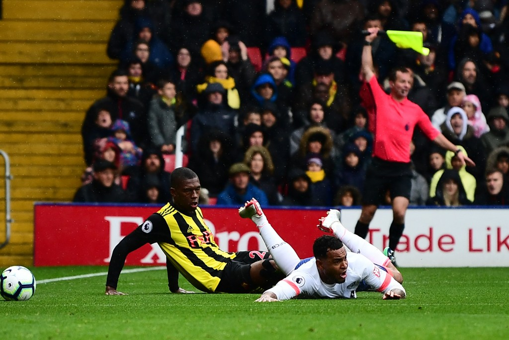 WATFORD, ENGLAND - OCTOBER 06: Callum Wilson of AFC Bournemouth is fouled by Christian Kabasele of Watford inside the penalty area, leading to a Bournemouth penalty, and a second yellow card, and therefore a red card for Christian Kabasele during the Premier League match between Watford FC and AFC Bournemouth at Vicarage Road on October 6, 2018 in Watford, United Kingdom. (Photo by Alex Broadway/Getty Images)