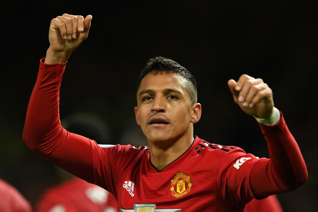 Manchester United's Chilean striker Alexis Sanchez celebrates after scoring the team's third goal during the English Premier League football match between Manchester United and Newcastle at Old Trafford in Manchester, north west England, on October 6, 2018. (Photo by Oli SCARFF / AFP) / RESTRICTED TO EDITORIAL USE. No use with unauthorized audio, video, data, fixture lists, club/league logos or 'live' services. Online in-match use limited to 120 images. An additional 40 images may be used in extra time. No video emulation. Social media in-match use limited to 120 images. An additional 40 images may be used in extra time. No use in betting publications, games or single club/league/player publications. / (Photo credit should read OLI SCARFF/AFP/Getty Images)