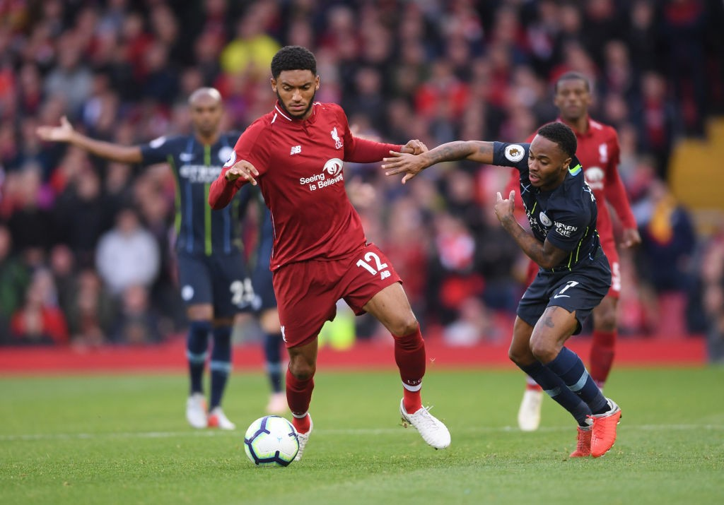 Joe Gomez and Raheem Sterling battle for possession