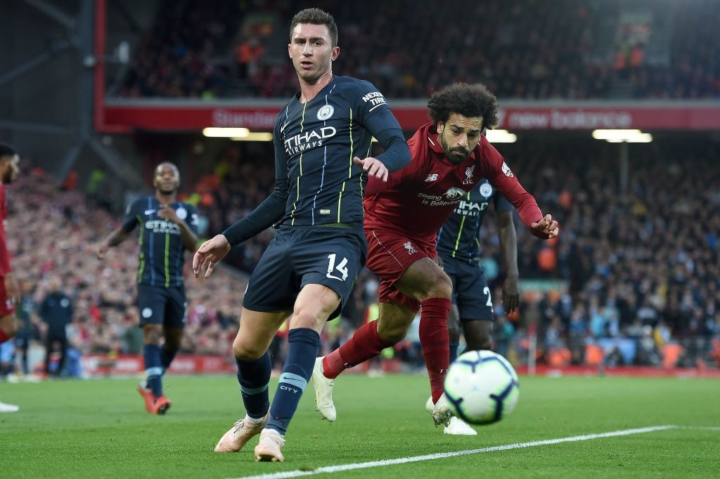 Aymeric Laporte (L) vies with Mohamed Salah