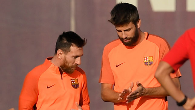 Long-time team-mates: Lionel Messi and Gerard Pique.