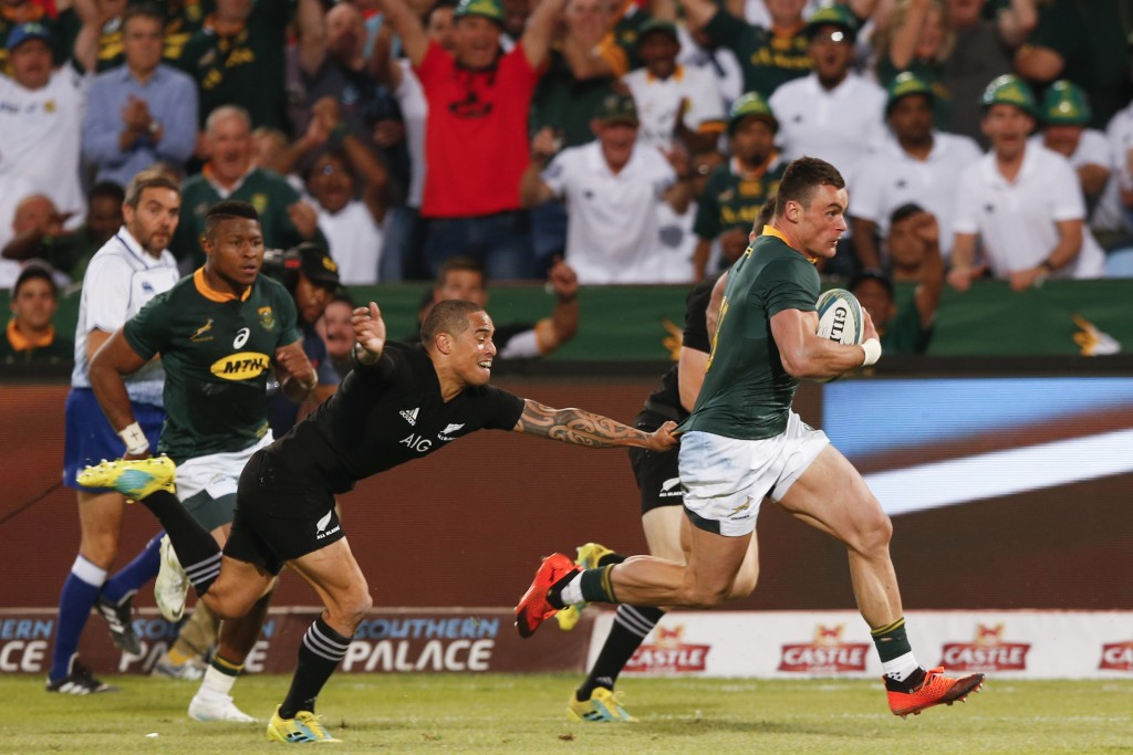 Jesse Kriel powers away to score the game's first try