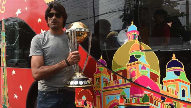 Mohammad Irfan displays the 2019 ICC World Cup trophy.