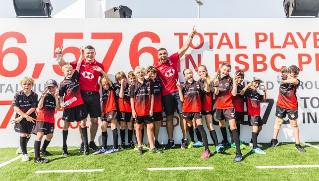 HSBC ambassadors O'Driscoll and Bryan Habana with schoolkids at the Dubai Sevens in December.