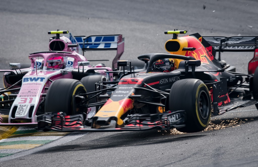 Ocon and Verstappen go wheel-to-wheel at Interlagos.