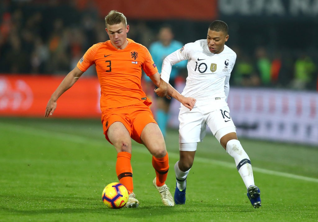 Matthijs de Ligt is challenged by Kylian Mbappe