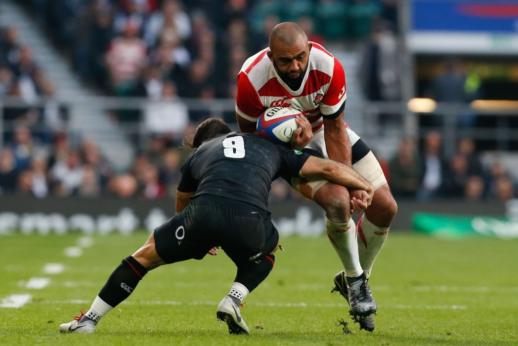 Michael Leitch breaks through the tackle of Danny Care to score at Twickenham