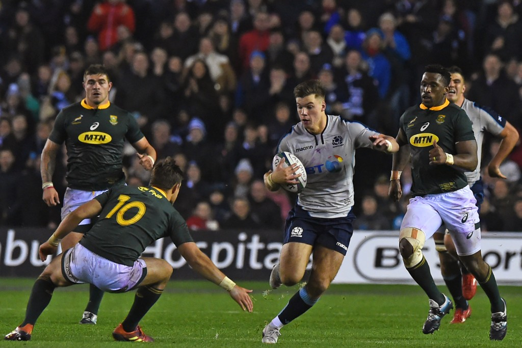 Scotland's centre Huw Jones evades a tackle from South Africa's fly-half Handre Pollard