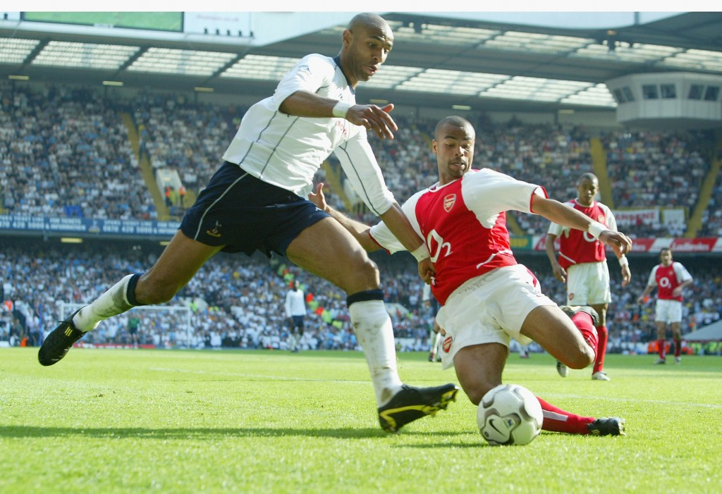 LONDON - APRIL 25: Frederic Kanoute of Spurs clashes with Ashley Cole of Arsenal during the FA Barclaycard Premiership match between Tottenham Hotspur and Arsenal at White Hart Lane on April 25, 2004 in London. (Photo by Ben Radford/Getty Images)