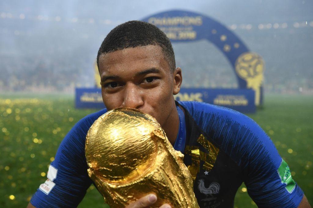 France's forward Kylian Mbappe kisses the World Cup