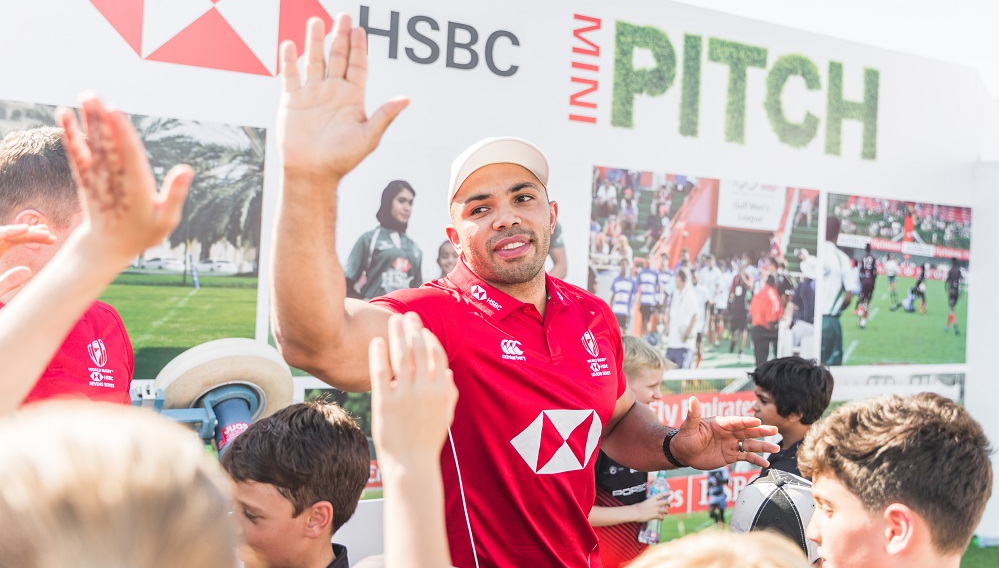 Habana with schoolkids at the Dubai Sevens on Thursday.